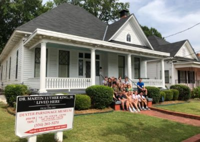 Students on the steps of Martin Luther King Jr.'s house in Alabama