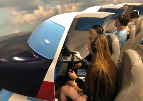 Students in a flight simulator