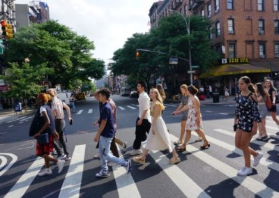 Students crossing a street in New York City