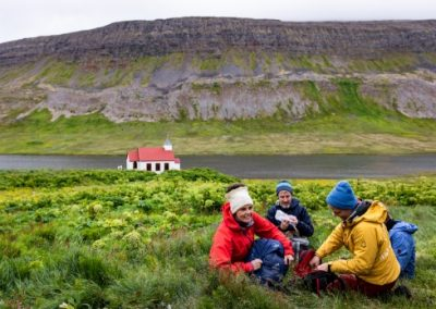 Students eating a picnic outdoors in Iceland